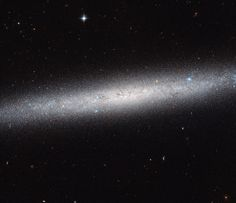 Hubble Views a Galaxy on Edge • This NASA/ESA Hubble Space Telescope image shows an edge-on view of the spiral galaxy NGC 5023. Due to its orientation we cannot appreciate its spiral arms, but we can admire the elegant profile of its disk. The galaxy lies over 30 million light-years away from us. - NGC 5023 is part of the M51 group of galaxies. The brightest galaxy in this group is Messier 51, the Whirlpool Galaxy, which has been captured by Hubble many times. NGC 5023 is less fond of the…