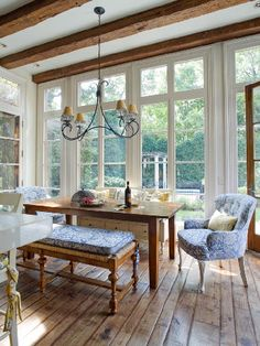 I'd love a huge, bright house like this. Rustic floor boards and high ceilings.