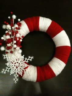 Candy Cane Holiday Wreath- This is probably the easiest idea to have your kids do. The styrofoam ring can be found in the craft section/store, yarn and any decorations you like to add. Wrap the yarn and tie off. Use yarn to tie the decorations on also. No gluing necessary. Instead of yarn you could use strips of wrapping paper and tape it around the ring.
