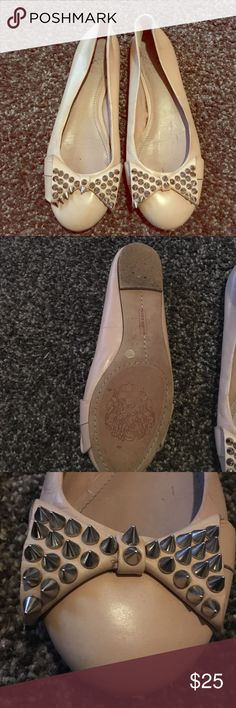 Vince Camuto Spiked Box Flats Selling these adorable Vince Camuto flats. They are a nude color and have this adorable bow at the toes decorated in spiked studs! Definitely have signs of wear but still have a lot of life left in them! Vince Camuto Shoes Flats & Loafers