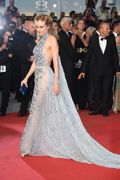 Diane Kruger wearing a powder blue embellished gown with a halter neck and see-through side panels at the 2015 Cannes Film Festival