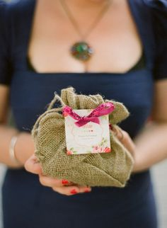 Individual Burlap Favor Bags (candy-filled ;) were placed at each place setting.