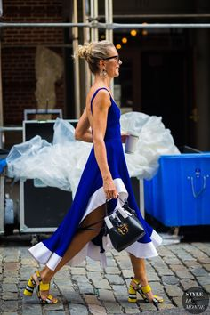 Loving this blue and white dress with an asymmetrical hem line summer street style look... here are our favorite pieces fashion girls are buying this week