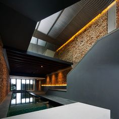 The Pool Shophouse by FARM and KD Architects.  A 1920s shophouse converted into a residence with a pool on the lower level.  Check out the sections - great spaces and circulation.