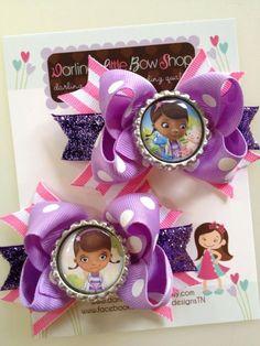 Doc McStuffins pigtail bows -- Set of 2 bows -- Doc McStuffins and Lambie hairbows. $11.95, via Etsy.
