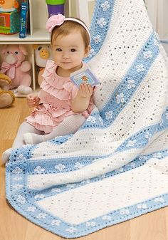 Ravelry: Lazy Daisy Blanket FREE pattern by Mary Jane Protus.  Red Heart Free Website.