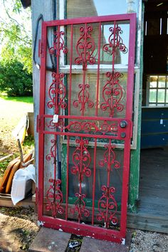 Red metal salvaged door- look for a size to fit the pantry! Instead of a wooden screen door??