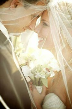 Romantic under-the-veil shot. You'll need with your fancy Mexican veil