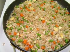If youve ever been to Benihana you will know that one of the highlights is the Chicken Rice they serve.  It is tasty and served right after their onion soup. I enjoy eating 1/2 the rice as an appetizer while waiting for my food to be cooked. I have read several recipes and have found an ingredient that makes this recipe more authentic. Hope you enjoy.