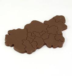 Das Ruhrgebiet als Schokoladentafel!  Die Schokoldenstücke bilden die Grenzen der Ruhrgebietsstädte ab. Auch die Flüsse Rhein und Ruhr dürfen nicht fehlen.