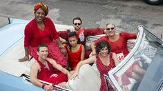 The NCIS: New Orleans team is seeing a lotta red -- and Agent Pride and the other fellas are showing a lotta leg! -- in these first photos from the CBS sophomore's Tuesday, Oct. 27 episode, which incorporates the city's annual Red Dress Run. Ncis Series, Tv Series, Female Actresses, Actors & Actresses, Red Dress Run, Zoe Mclellan, Ncis Gibbs Rules, Ncis Cast, Lucas Black