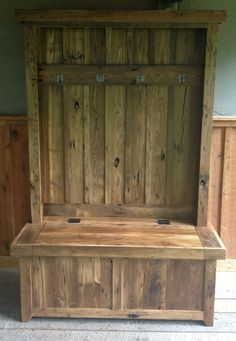 This hall tree is hand crafted from 100 year old wormy chestnut barnwood. Base has hinged door for easy storage and the four hooks are aged brass. Hall Tree Dimensions: Width: 42 x Depth: 20 x Height: 72 (Please ask about customizing the dimensions) Pallet Furniture Plans, Reclaimed Furniture, Furniture Decor, Hallway Furniture, Bedroom Furniture, Indoor Storage Bench, Hall Tree Storage Bench, Hall Bench, Tree Bench