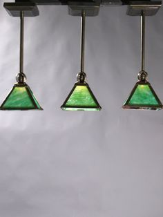"""Circa 1915, we have 6 Hammered Arts and Crafts Pendants with green slag glass and cast brass shade holders and frames. 21"""" drop x 6 1/4"""" width x 6"""" shade length. $990.00 each"""