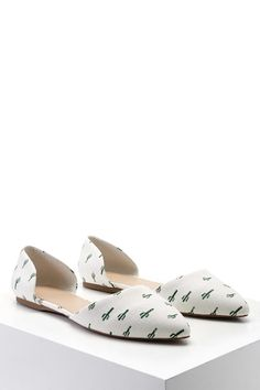 A canvas d'Orsay flat featuring an allover distressed cactus print, a pointed toe, and side cutouts.