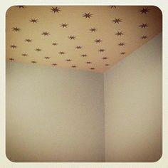 Gold star stencils on ceiling