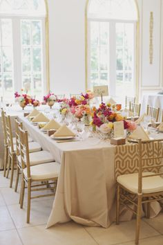 Wedding Reception: Place settings - gold/neutrals & Centerpieces - color pop using flowers