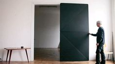 "Austrian artist Klemens Torggler has reinvented the door with his latest project.  Called the Evolution Door, the 4-panel door opens and closes elegantly as though it's made of pieces of paper. Roggler calls it a ""flip panel door"" (or ""Dryehplattentür""). Feb. 10, 2014 Read more: http://www.businessinsider.com/klemens-torgglers-kinectic- door-2014-2#ixzz2szCNrhKp #doors #design"