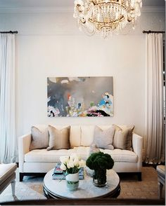 I love the neutrals with the pop from the abstract painting!