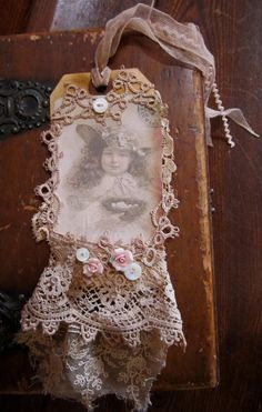 Vintage Lace Collage Victorian Sepia Girl in hat with Bird Nest  Embellished Tag. $14.99, via Etsy.
