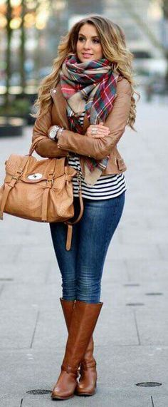 brown leather jacket, plaid blanket scarf, striped tee, skinny jeans, brown tall boots