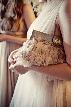 A feather clutch, it's a nice touch and keeps all Audrey's necessities close by.