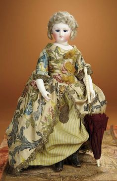 French Bisque Poupee with Superb Embroidered Silk Costume and Bisque Arms 2500/3200