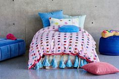 Layer up! Cloudy days delight duvet cover teamed perfectly with Kip & Co's sought after tassel blankets.