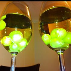 Freeze green grapes to keep white wine cold and to make a pretty presentation for guests! Such a great idea!