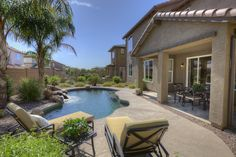 Gorgeous outdoor spaces!  Sit poolside with friends and family in this gorgeous oasis!