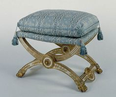 A folding stool circa 1786, from a set of sixty-four for Marie Antoinette's gaming rooms at the palaces of Fontainebleau and Compiègne. They were originally covered with painted satin.