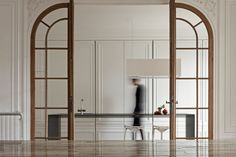 "Dutch interior architecture firm i29 created a stunning ""Invisible Kitchen"" that nearly disappears into this equally stunning Paris apartment."