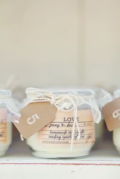 love candle favors - homemade soya candles packaged in jar with lace and custom label.
