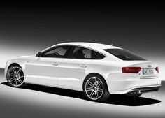 2014 Audi A5. Looks gorgeous even in white, and that's saying something!