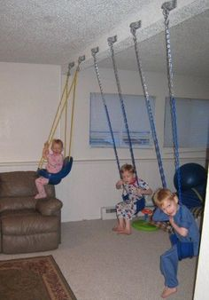 Indoor Swing Set... this is the most awesome thing ever. Put in front of TV and keeps them active even while cartooning! Now...if only there was a support beam that would hold adult too!