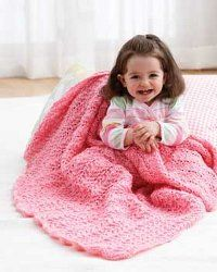 """Lacy Stitch Blanket. 3 balls Bernat® Baby Coordinates.  Circ. US# 8, 36"""".  CO 217 sts. Knit 5 rows (garter st). Proceed in pat as follows: 1st row: (RS). K4. *yo. K3. Sl1. K2tog. psso. K3. yo. K1. Rep from * to last 3 sts. K3.  2nd row: K3. Purl to last 3 sts. K3.  3rd row: As 1st row.  4th row: Knit.  These 4 rows form pat. Cont in pat until work from beg measures approx 47"""", ending with 2nd row of pat.  Knit 5 rows. Cast off knitwise."""