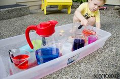 A no-cost, high fun toddler activity using just water and cups. Create a simple pouring station that will hold your toddler's attention for a long while.