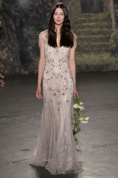 We're drooling over this beaded blush-toned wedding dress.