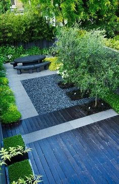 OVERVIEW OF SMALL CONTEMPORARY GARDEN AND TERRACE BY CHARLOTTE ROWE