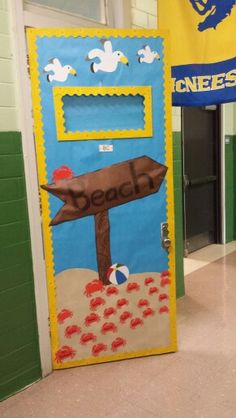 Beach themed classroom door with crabs and sea gulls