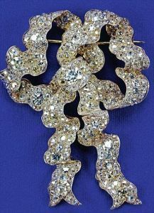 The Queens true lovers knot diamond brooch inherited from Queen Mary.