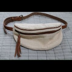 UO Boho Fanny Pack Perfect for the summer time! It has a zipper in the front and a small one in the back. Used a couple of times, but in perfect condition. Make me an offer! Ecote Bags Hobos