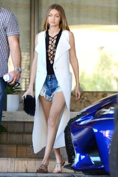 11 unique and stylish bathing suit cover up ideas to try before summer 2016 ends: denim cutoff shorts and a duster vest as spotted on Gigi Hadid