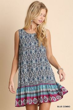Blue boho print with contrast color borders, sleeveless, and button keyhole back closure. Ruffled hemline. Soft and comfy cotton blend 65% cotton 35% polyester. Pair with cowboy boots for a southern country look or dress it down with flip flops for an easy throw on and go summer dress. We measure Umgee clothing in house so you get the right fit. Click image for measurements
