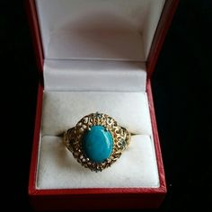 Sterling ring w/gold tone overlay Gold tone filligree with turquoise color stone. Stamped sterling.  Tiny blue crystals may be topaz? liam Jewelry Rings