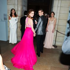 Emma Stone and Andrew Garfield held hands on their way into the event.