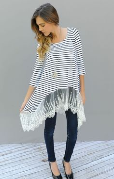This is a long tunic with a 3/4 sleeve. The best part that each top has a beautiful lace connected at the bottom.