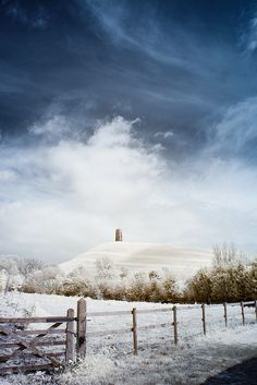 Snow on the Tor, Glastonbury, England. Th scene in Salome's Daughters takes place in the snow. Glastonbury Tor, Glastonbury England, Glastonbury Somerset, Yule, Places Around The World, Around The Worlds, Mists Of Avalon, Winter Magic, Winter Scenery