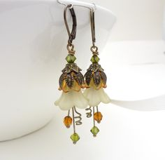 Beading ideas and inspiration. Green brown earrings, green flower jewelry, autumn brown green dangle earrings, brown lucite flower earrings, mustard, olive, beaded jewelry. $22.00, via Etsy.