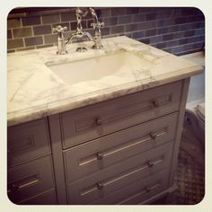 bath room w marble counter. I would like a similar color countertop in the kitchen. But not marble