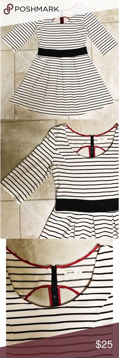 Cute striped summer sun dress with back cutout Striped cream and black dress with red accents and a back cutout. Good condition, only worn a few times. Does have some minor piling in the back as shown in the last photo. Size L. Please ask any questions prior to purchasing. Reasonable offers welcome. No trades. Dresses